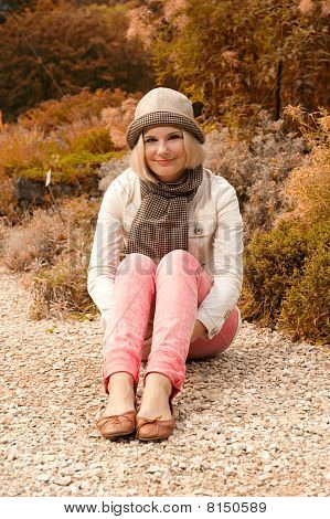 young beautiful woman in autumn park having fun