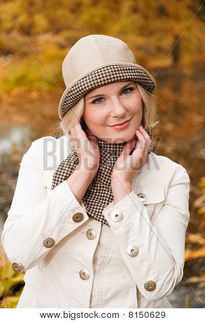 young beautiful woman in autumn park having fun