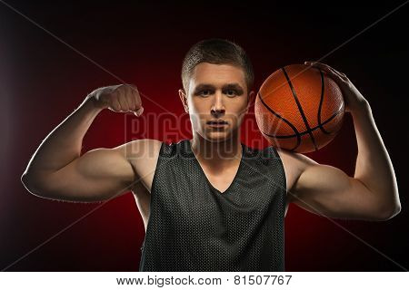 Caucasian basketball athlete demonstrating his biceps