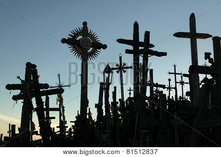 SIAULIAI, LITHUANIA - AUGUST 1, 2013: Wooden crosses at the Hill of Crosses, the most important Lithuanian Catholic pilgrimage site located near the town of Siauliai in Northern Lithuania.
