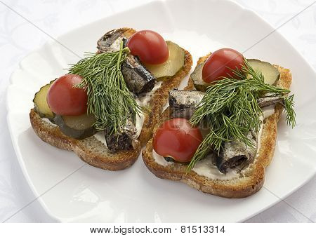 Sandwiches with sprats ,cucumbers and tomatoes