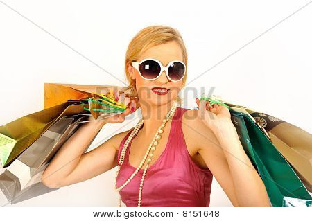 Young Beautiful Shopping Woman With Lots Of Shopping Bags. Isolated On White Background