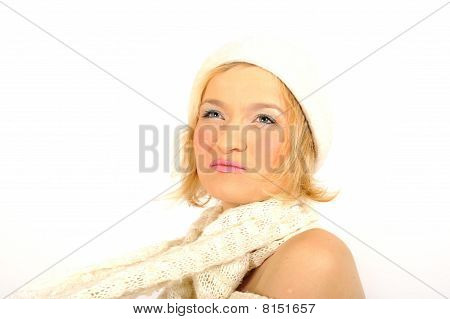 Young Happy Winter Woman With White Scarf And Hat. Isolated On White Background