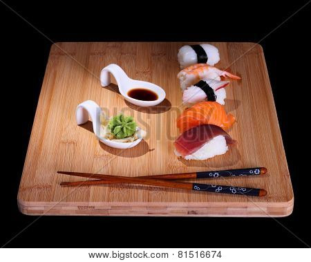 Five Species Of Fish Sushi On Bamboo Board