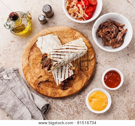 Doner Kebab Grilled Meat And Vegetables On Stone Textured Background