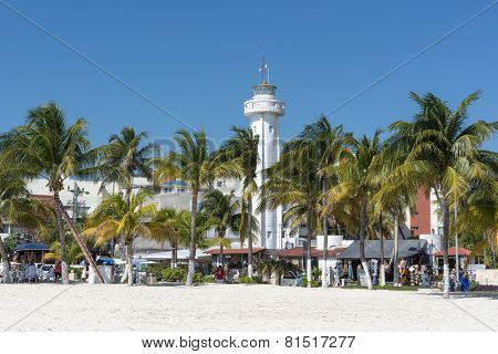 ISLA MUJERES - JANUARY 21: Lighthouse near the beach on 21 January 2015 in Isla Mujeres, Mexico. The island is located 8 miles east of Cancun in the Gulf of Mexico.