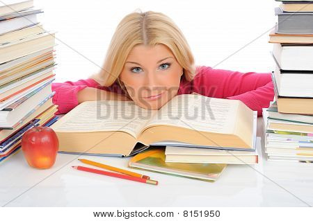 Young Pretty Tired Student Girl With Lots Of Books In Panic. Isolated On White Background