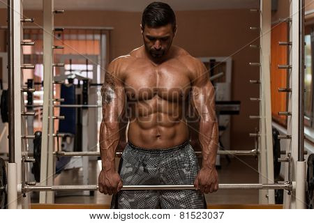 Bodybuilder Doing Trapezius Exercise