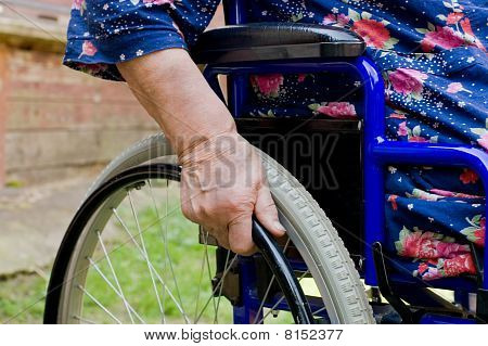 Hand Of The Old Woman On An Invalid Armchair