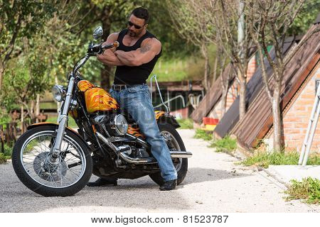 Biker In Sunglasses On The Road