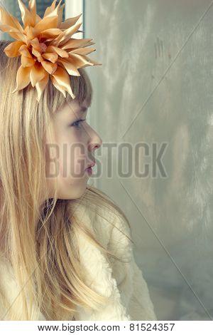 girl looking at it behind window