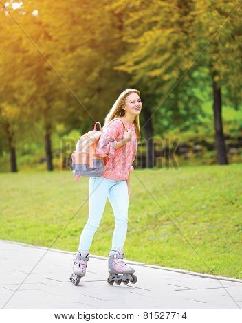 Fashion, Extreme, Vacation And People Concept - Pretty Stylish Smiling Girl Rollerblading In The Cit