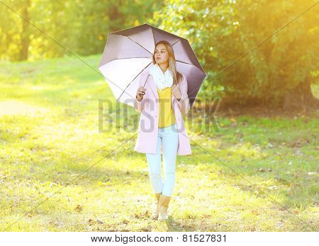 Petty Sensual Woman With Umbrella In Sunny Autumn Day