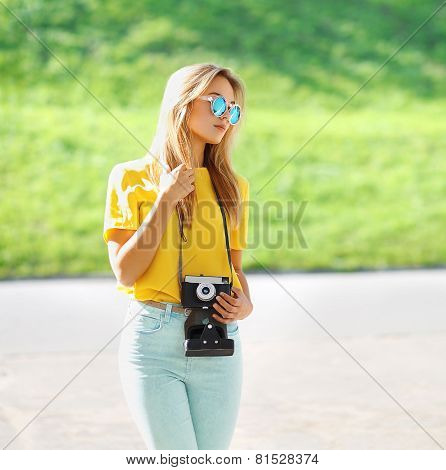 Summer, Fashion And People Concept - Stylish Pretty Modern Girl In Sunglasses With Retro Vintage Cam