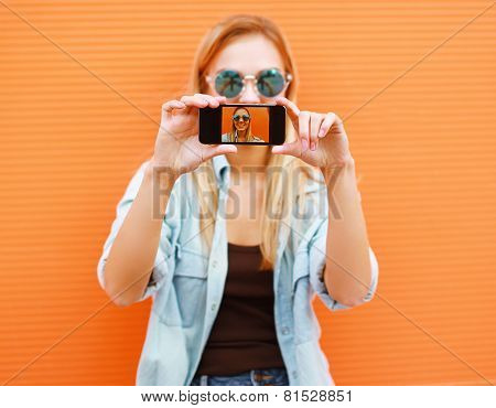 Summer, Fun, Technology And People Concept - Cool Girl Makes Self-portrait On The Smartphone Outdoor