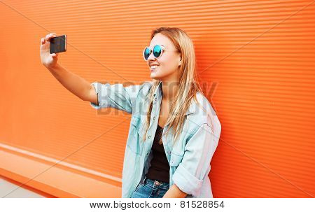 Summer, Fun, Technology And People Concept - Cool Hipster Girl Makes Self-portrait On The Smartphone