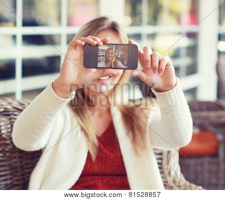 Technology, Mobile And People Concept - Happy Woman Makes Self-portrait On The Smartphone Outdoors