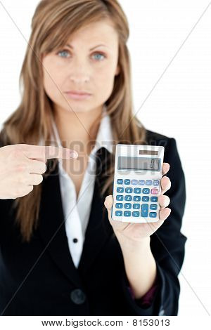 Depressed Businesswoman Holidng A Calculator