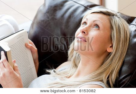Surprised Woman Looking Up Holding A Book