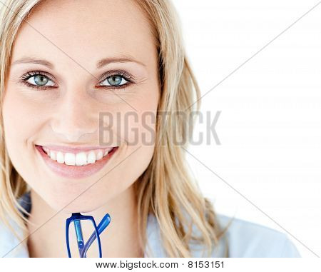 Close-up Of A Smiling Woman Holding Glasses Looking At The Camera