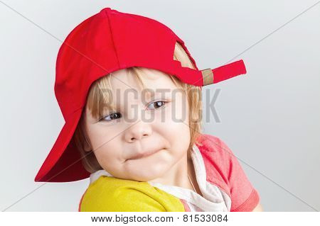 Funny Smiling Baby Girl In Red Baseball Cap