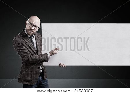 Man Holding Blank Paper On Gray Background