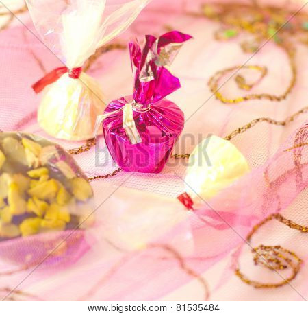 Assorted white chocolate toffees on a colorful background