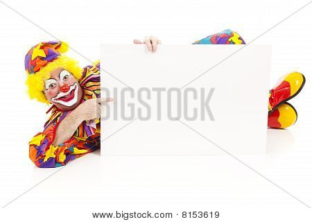 Clown Lies Down With Sign