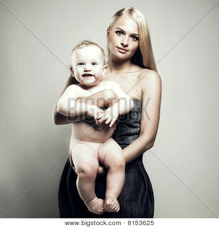 Beautiful Young Mom With Naked Baby