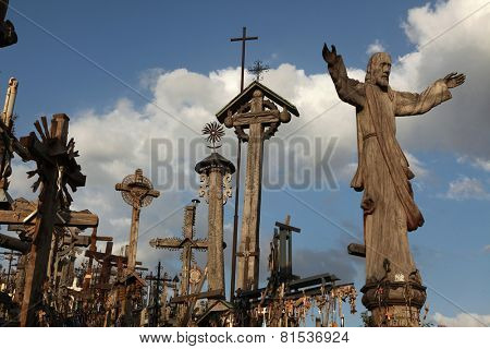 SIAULIAI, LITHUANIA - AUGUST 5, 2013: Wooden statue of Jesus Christ at the Hill of Crosses, the most important Lithuanian Catholic pilgrimage site near the town of Siauliai in Northern Lithuania.