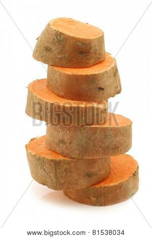 stacked sweet potato slices on a white background