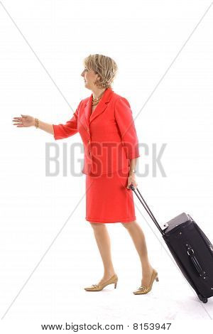 woman walking with luggage