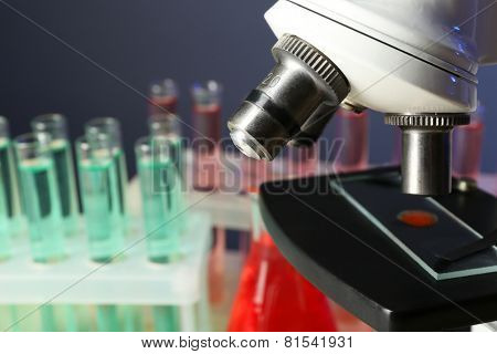 Microscope on test tubes background