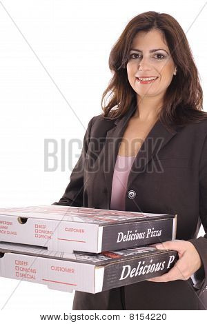 happy woman in business suit carrying pizzas