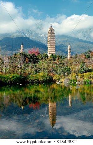 Ancient pagoda in Dali old town with lake reflection, Yunnan, China.
