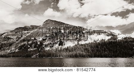 Snow mountain cloud and lake panorama with reflections in Yosemite BW.