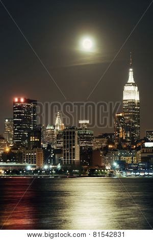 Moon rise over midtown Manhattan with city skyline at night