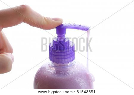 Woman hands using soap dispenser isolated on white