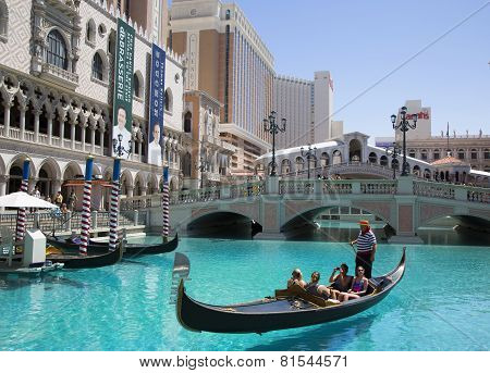 Unidentified tourists enjoy gondola ride at Grand Canal at The Venetian Resort Hotel Casino