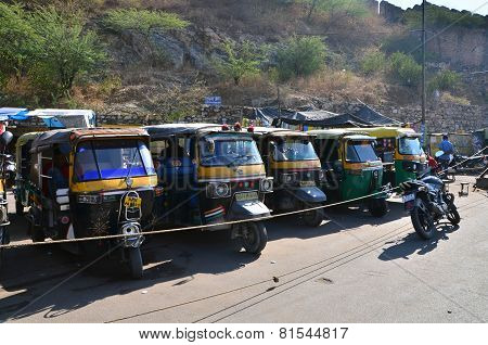 Jaipur, India - December 29, 2014:  Auto Rickshaw Taxis Near Amber Fort