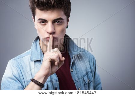 Teenager Boy Making Silence Gesture