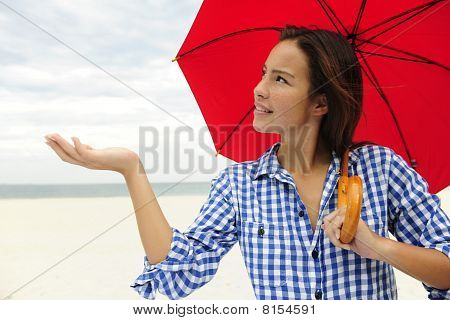 Woman With Umbrella Touching The Rain