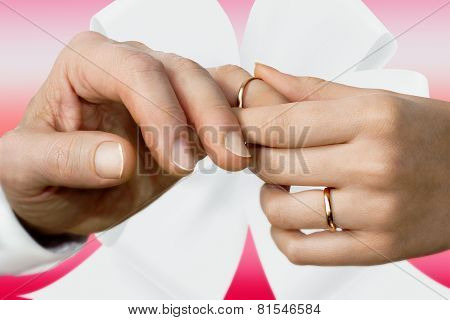 Woman's Hand Putting On A Wedding Ring On A Man's Finger