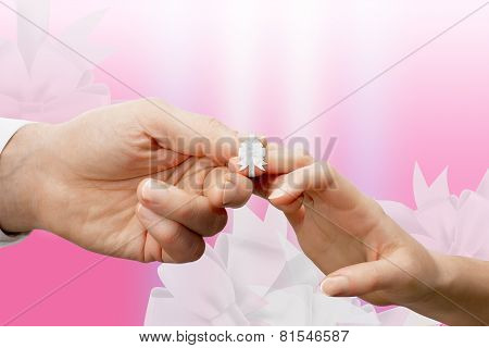 Woman's And Man's Fingers Tied With A White Ribbon