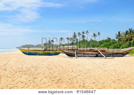 Old Fishing Boat On The Sandy Shore
