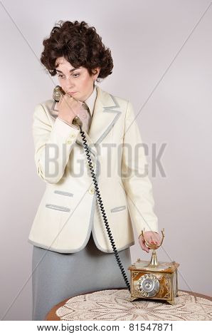 Woman on the retro telephone