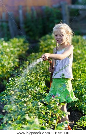 The Girl In A Kitchen Garden