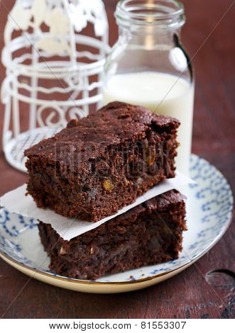 Citrus And Nut Chocolate Brownie Slices And Bottle Of Milk