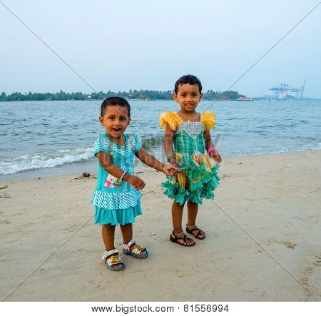 Kochi, India - February 25: An Unidentified Little Girls Standing On The Beach And Are Holding Hands