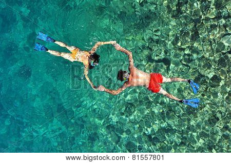 Romantic Couple Snorkeling In Phi Phi Island, Thailand
